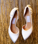 Bride's Lanvin shoes with ruched detail in the back