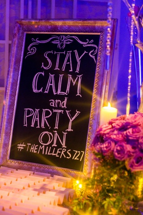 Stay Calm and Party On sign with hashtag at escort card table