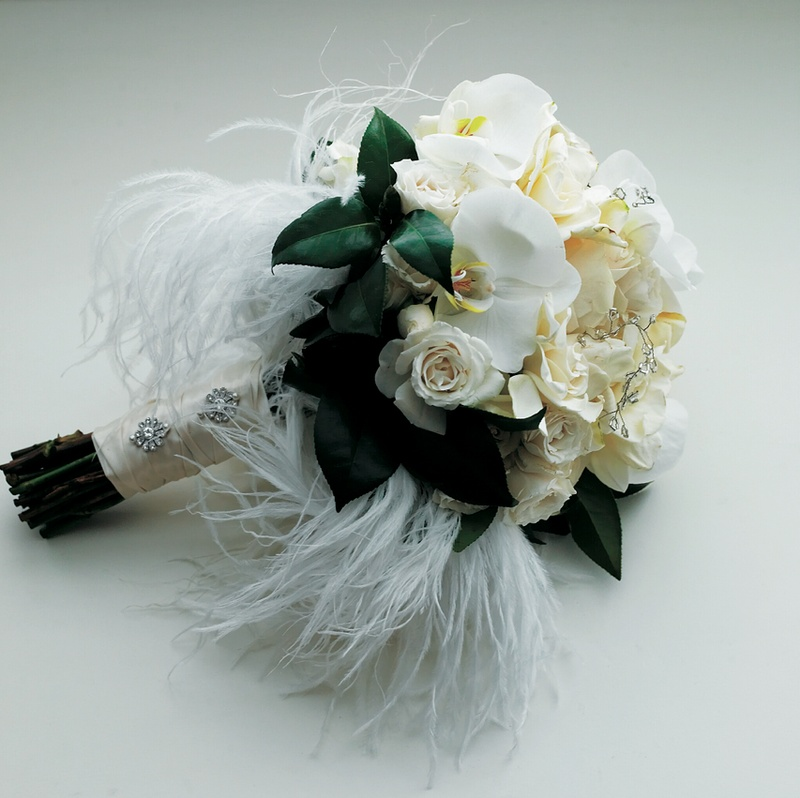 White and ivory flowers with ostrich feathers