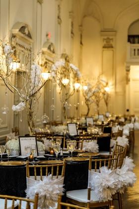 gold chiavari chairs, black linens, gold charger plates, gold manzanita branches