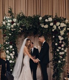 Suzanna Villarreal and Alex Wood LA Dodgers wedding ceremony greenery burgundy white flowers