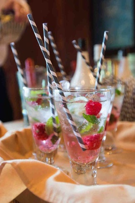 Black and white straw with raspberries and water