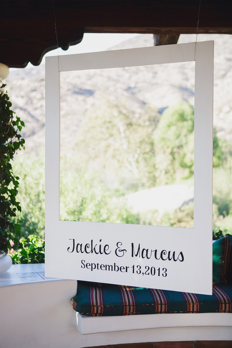 Large Polaroid picture cut out with bride and groom's names and wedding date