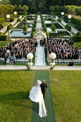 Wedding ceremony in the landscaped garden of Oheka Castle