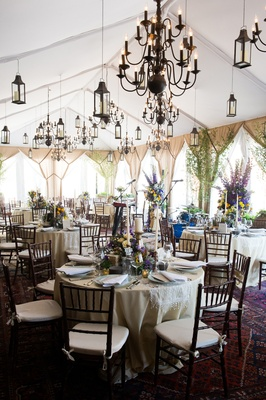 tented rooftop space vintage chandeliers round tables new york city bridal party event