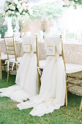 couple chair signage flowing fabric gold ivory south carolina tented wedding reception royal regal