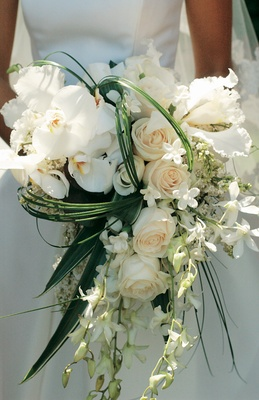 Wedding bouquet with roses, orchids, and palm fronds