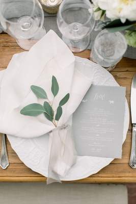 wedding reception wood table eucalyptus greenery in napkin sheer ribbon china grey menu card white