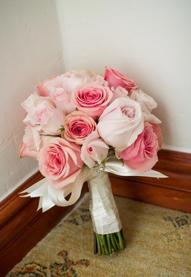 Pink and blush roses wrapped in satin ribbon