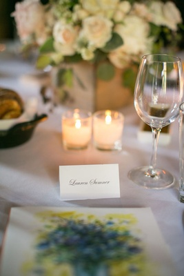 Ranch wedding reception with name written on white place card in script