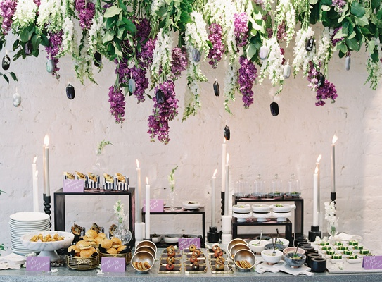 wedding event food display purple white wisteria greenery black white decor appetizers