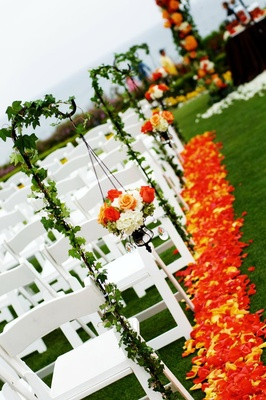Orange and yellow petals along aisle