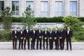 groom and groomsmen in front of chicago wedding venue classic tuxedo attire