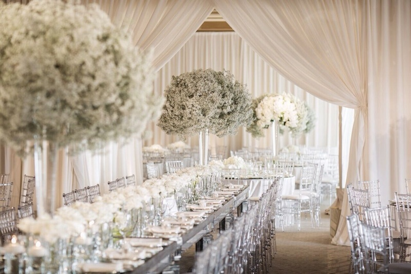 Effervescent babie's breath, lucite chairs and mirrored surfaces enforced the subtle modernity of th