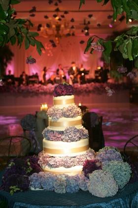 Four layer wedding cake with hydrangea decorations