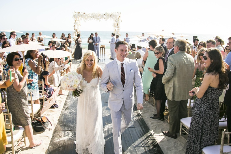 Bride and groom walking on wooden plank