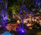 Night photo of outdoor pool cabana reception