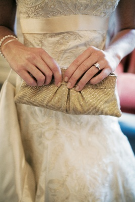 Bride holding clutch with sparkling sequins