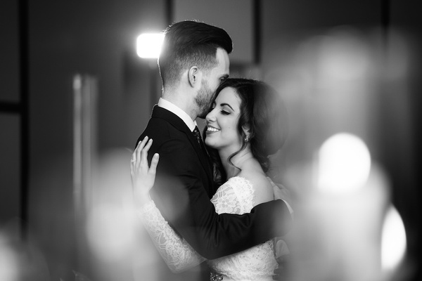 Black and white photo of newlyweds hugging