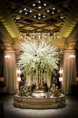 fountain in the drake hotel with a large arrangement of flowers with cascading orchids