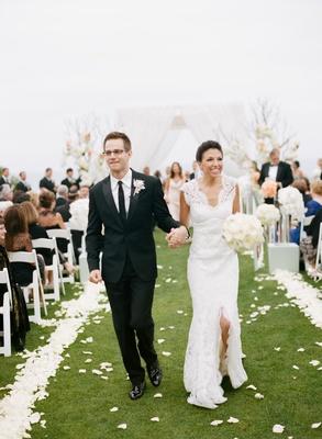 Couple exit alfresco ceremony holding hands