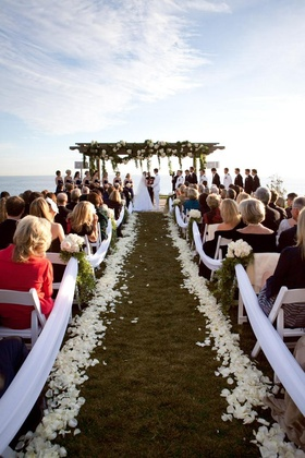 Ivory petal-lined aisle and wedding canopy
