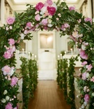 Garland of greenery in church with pink peonies