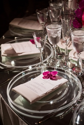 Wedding reception table mirror tabletop clear charger plate single orchid blooms silver rim glass