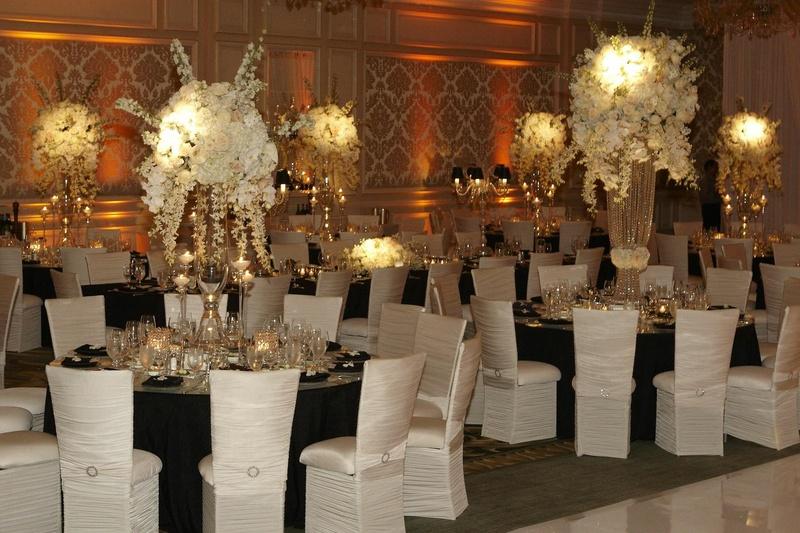 Chameleon chairs around black wedding tables