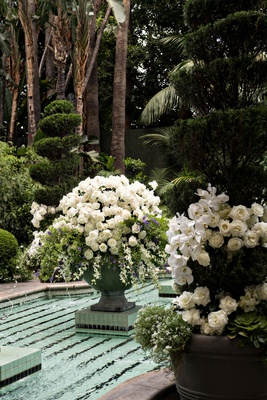 wedding reception four seasons hotel los angeles at beverly hills white rose orchid flowers greenery