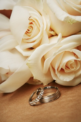 Ivory roses behind platinum or silver jewelry