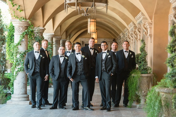 Groom in tuxedo and bow tie with groomsmen in matching outfits villa venue in arizona villa siena
