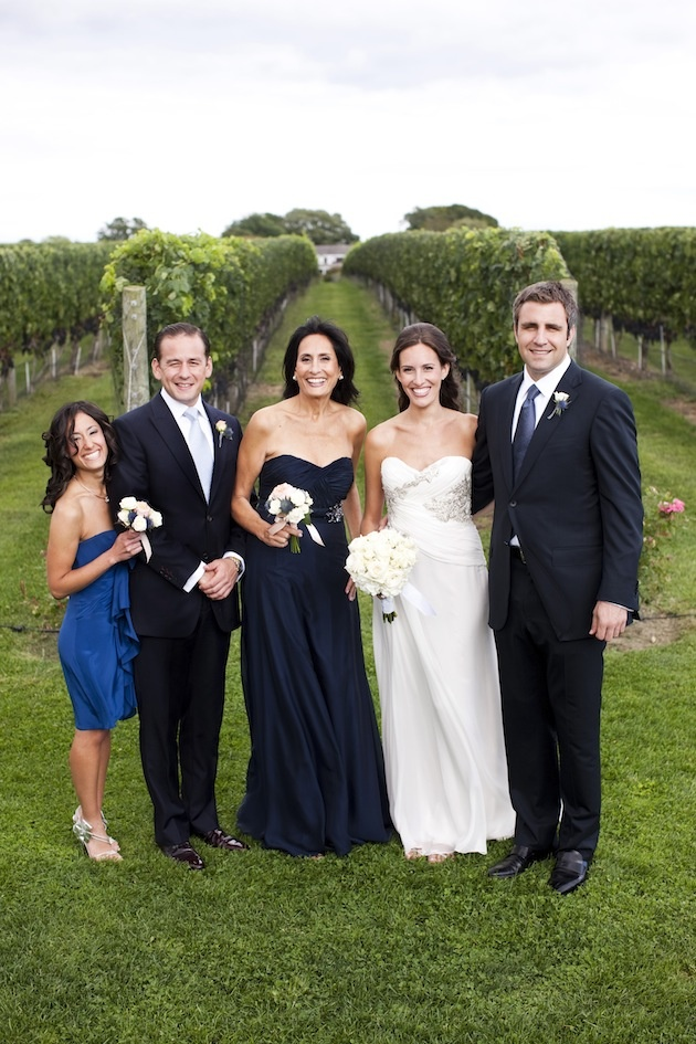 Newlyweds with mother-of-the-bride in vineyard