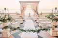 ca' d'van wedding ceremony on porch overlooking ocean, chiavari chairs in half circle, blush chuppah