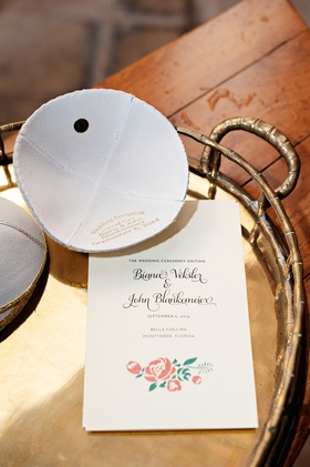 Jewish wedding ceremony with ivory leather yarmulke stamped with the couple's names and wedding date