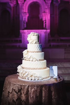 Wedding cake five layer fondant confection sugar flowers wrapping around each layer moroccan lace