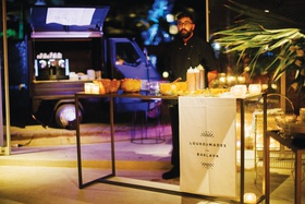 destination wedding in mykonos greece loukoumade and baklava desserts station espresso truck