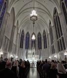 Wedding ceremony at cathedral sanctuary church in Chicago stained glass windows chandelier lighting