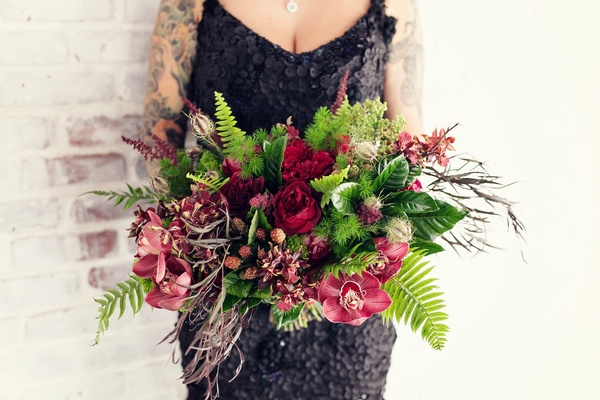 Red orchid and flower wedding bouquet with greenery and ferns