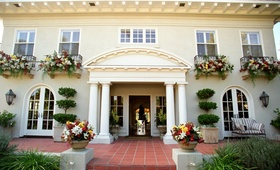 Mansion wedding venue in Mission Hills with white and red flowers