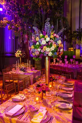 Purple and pink lighting on gold tablescape