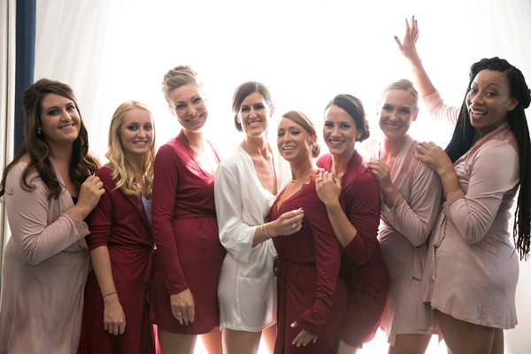 bride bridesmaids different hued robes getting ready california wedding girlfriends