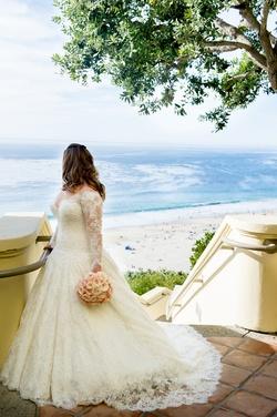 Plus size bride in Mark Zunino wedding dress