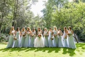 bride in a line wedding dress with bridesmaids in light blue dresses high neck floor length
