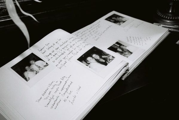 Black and white image of polaroid picture guest book