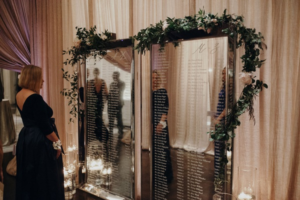 Suzanna Villarreal and Alex Wood LA Dodgers wedding seating chart mirror with etched names garland