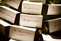 Wedding reception place cards arranged on greenery