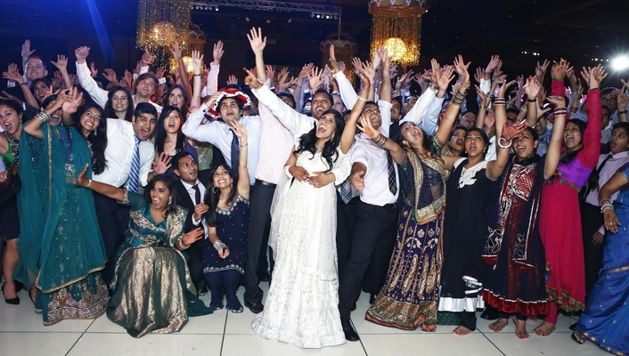 Indian bride and groom celebrate with guests at reception