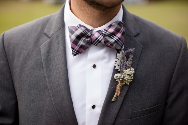 Groomsman in plaid bow tie with dusty miller