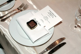 Place setting with menu, table card, and chocolate